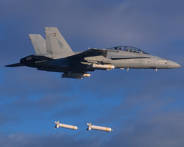 F/A-18D from VMFA(AW)-533 drops CBU-99 Cluster Bombs during a squadron deployment to El Centro, CA.